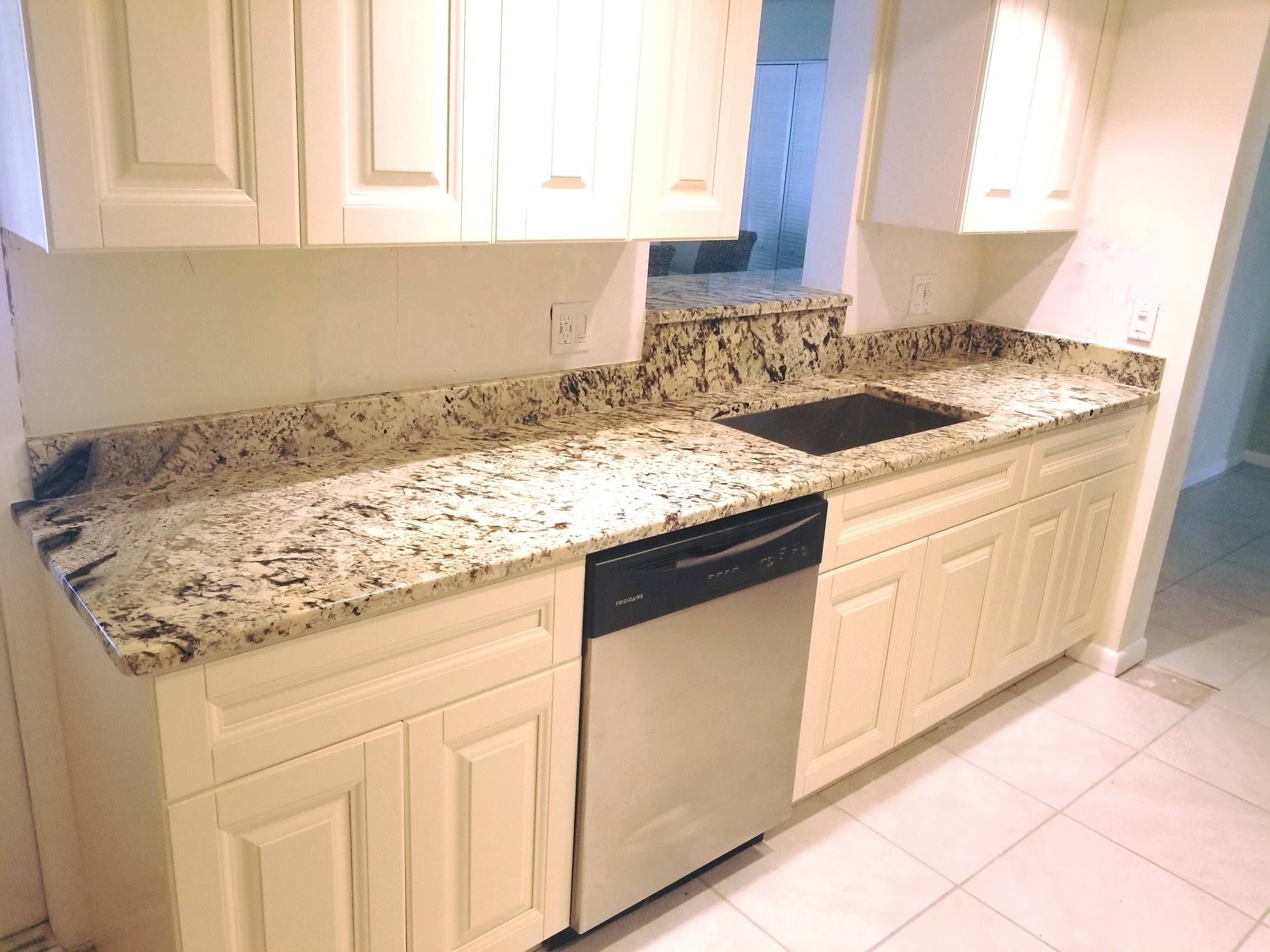 Beautifully Designed Polished Kitchen Countertop Using Pears White Color Granite Installed By Kb Fa Kitchen Countertops Natural Stone Countertops Countertops