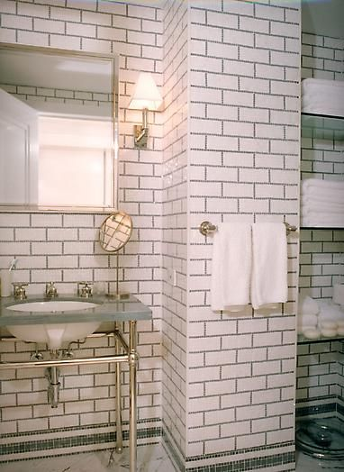Bathroom Subway Tile Dark Grout floor to ceiling subway tile, dark grout, and open glass shelving