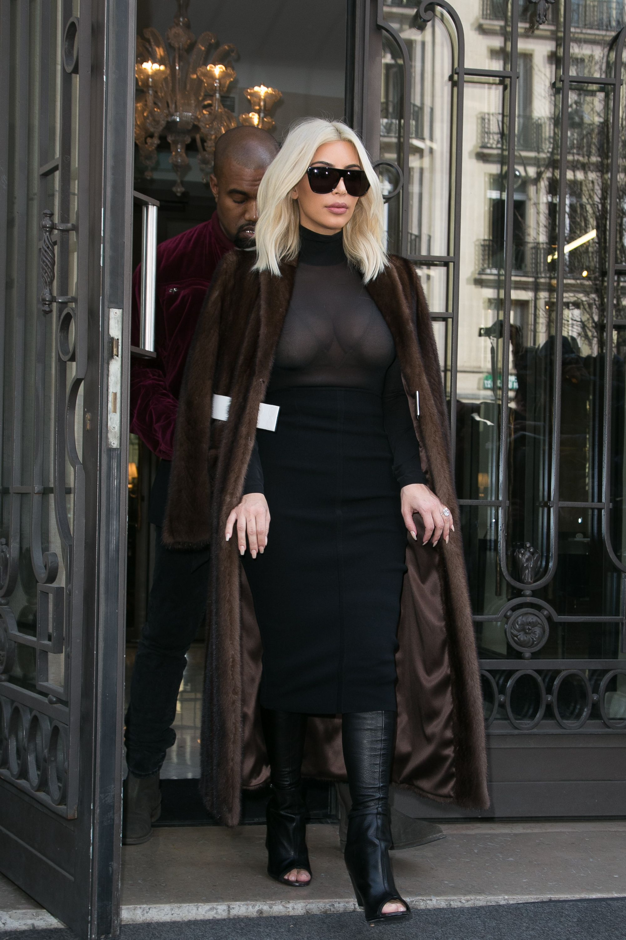 In a Givenchy coat and boots, Wolford turtleneck, and Proenza Schouler skirt while out in Paris.   - ELLE.com