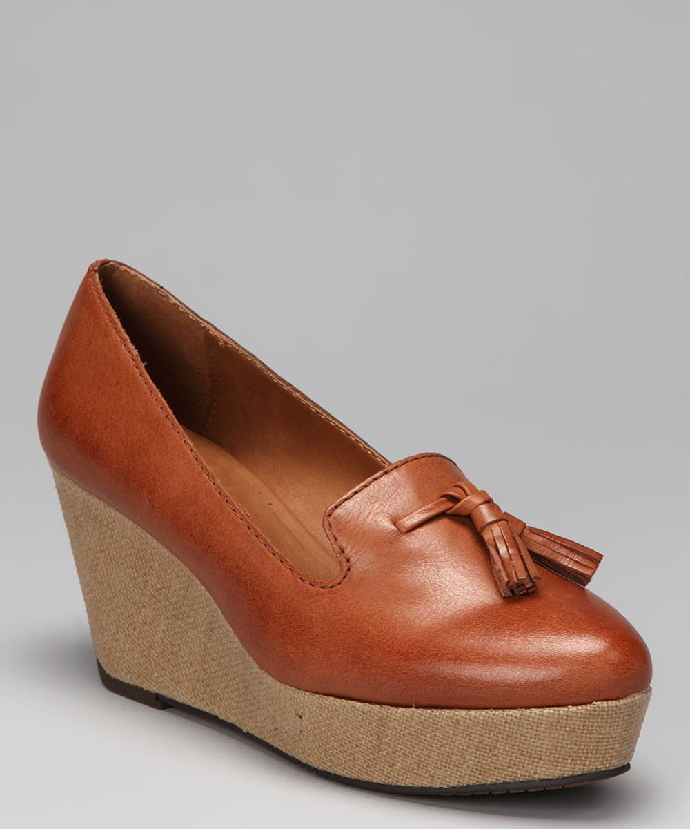 cognac shainy wedge loafer >>> calvin klein--would be super cute if less platformy.