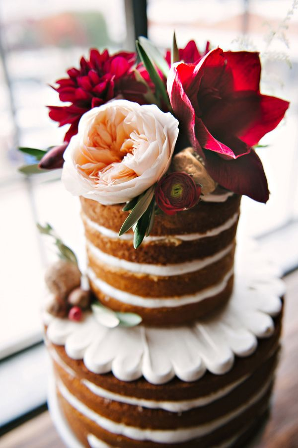 Naked cake with floral accents. Could be easily made at home for super cheap & still super cute!