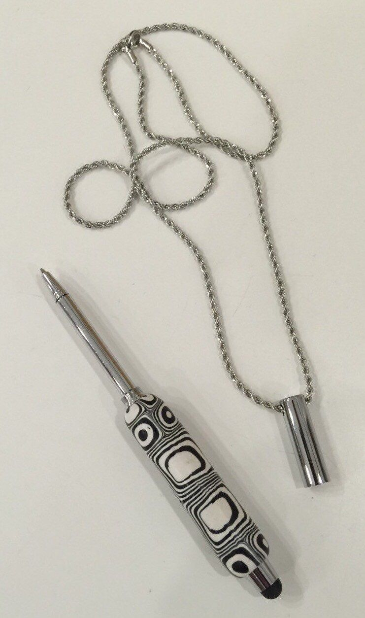 A personal favorite from my Etsy shop https://www.etsy.com/listing/280704696/black-white-retro-telescoping-pen