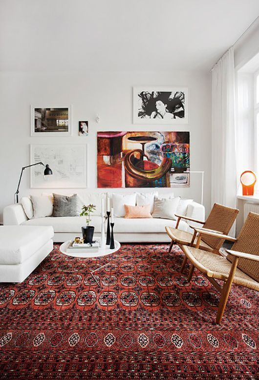 Warm cozy living room with oriental rug white sofa danish modern chairs gallery art wall also using marsala in your decor pantone pinterest