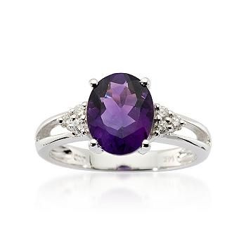 Deep jewel tones of purple captivate in this 2.35 carat amethyst ring. Color comes to light with the .10 ct. t.w. diamond highlights. Note the open shank that allows the light to explode on this ring, set in 14kt white gold
