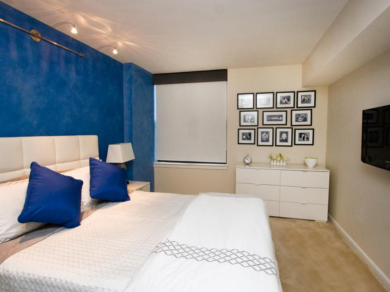 Blue And White Bedroom With Accent Wall And Framed Collage Art