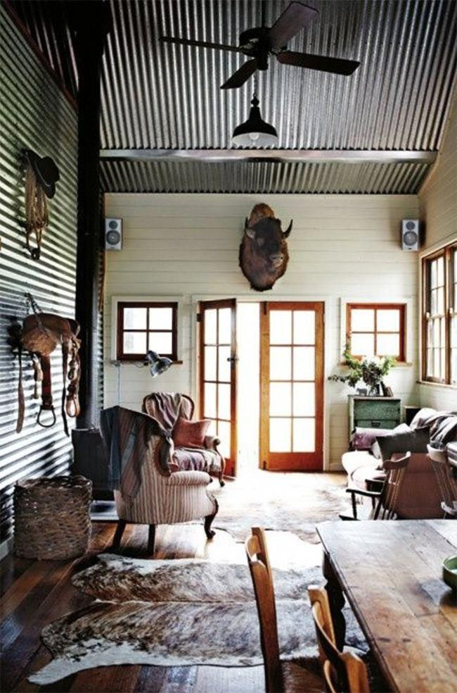 Western saddle hanging on the wall westerndecordiy mikes house in metal buildings building homes also rh pinterest