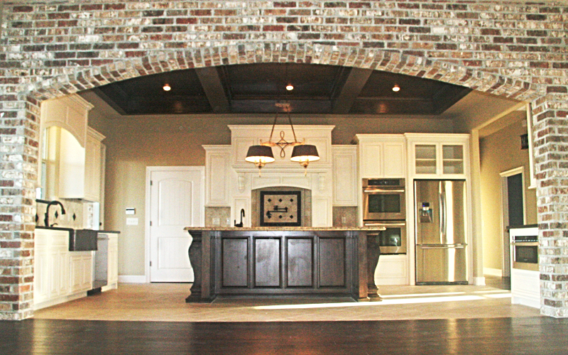 the acadian dream home gallery open to kitchen through widened arch - Home Gallery Design