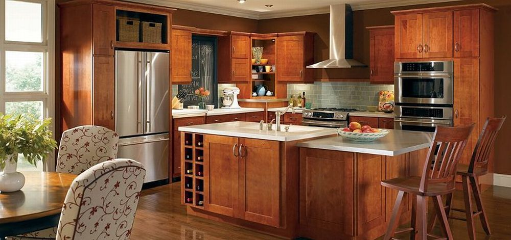 They are providing your kitchen a warm light; tables are a ...