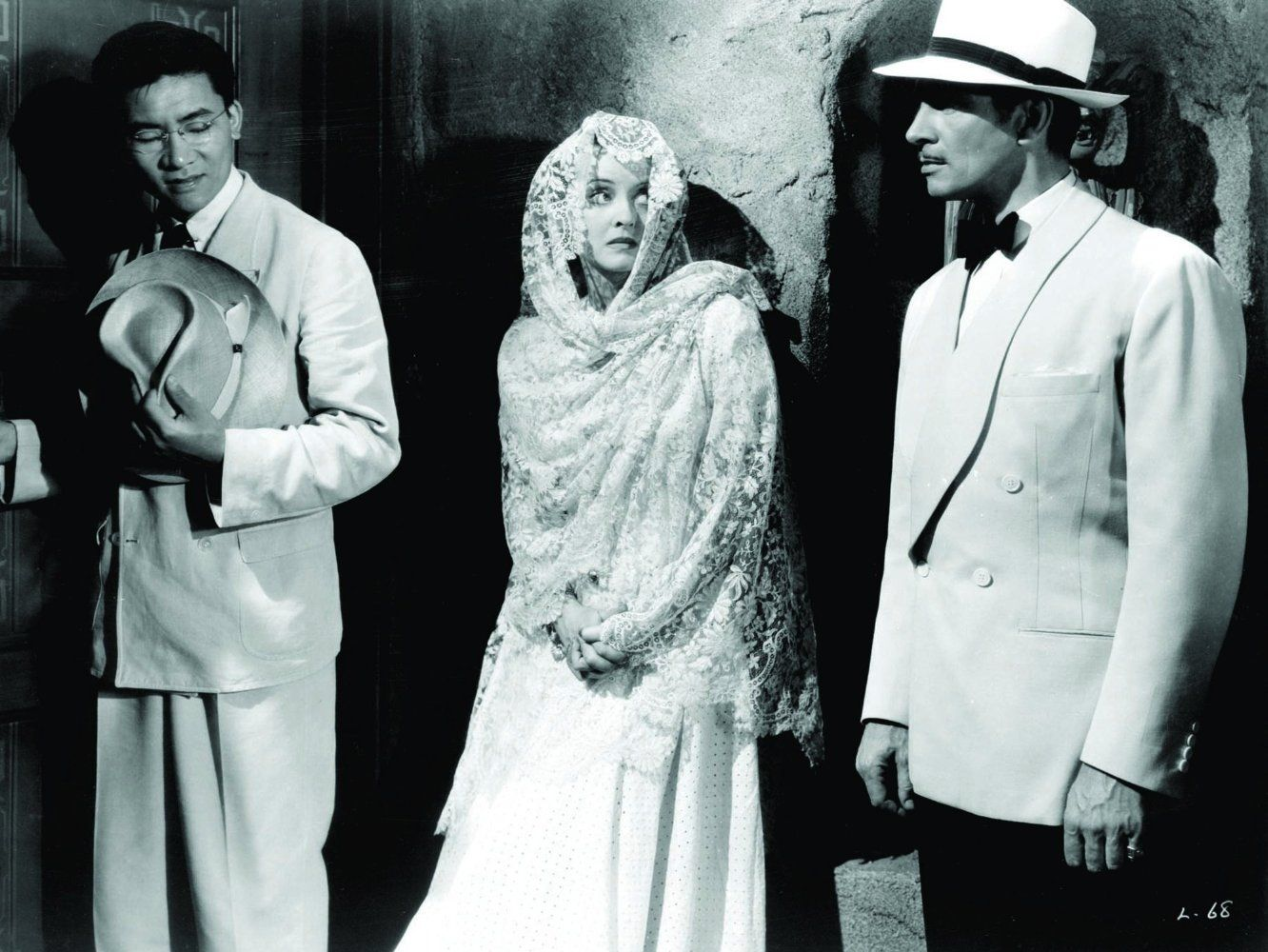Victor Sen Yung, Bette Davis, and James Stephenson in a production still for The Letter (1940).