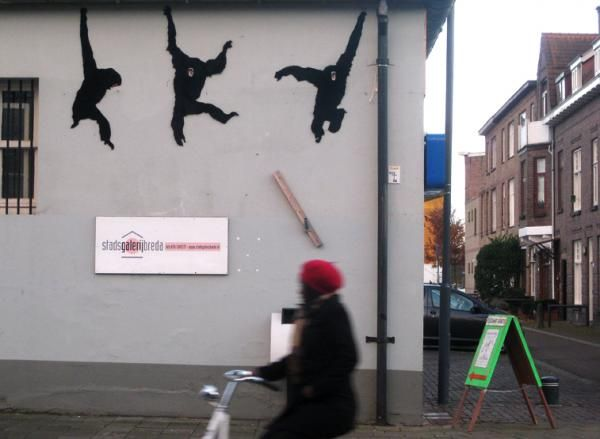Street Art by Neozoon | Cuded Recycled fur transformed into apes swinging cheerfully through the city.