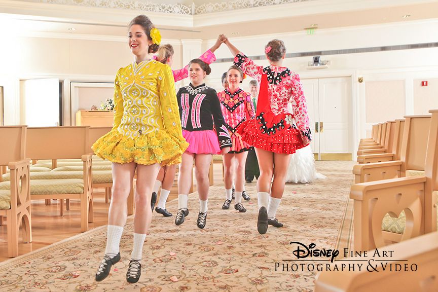 Irish dancers set the stage as the bride begins to proceed down the aisle at Disney's Wedding Pavilion #irishdancers #riverdance #entertainment #Disney #wedding #WeddingPavilion