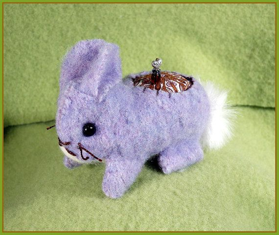 Is this not the cutest? Felted sweaters made into pin cushions