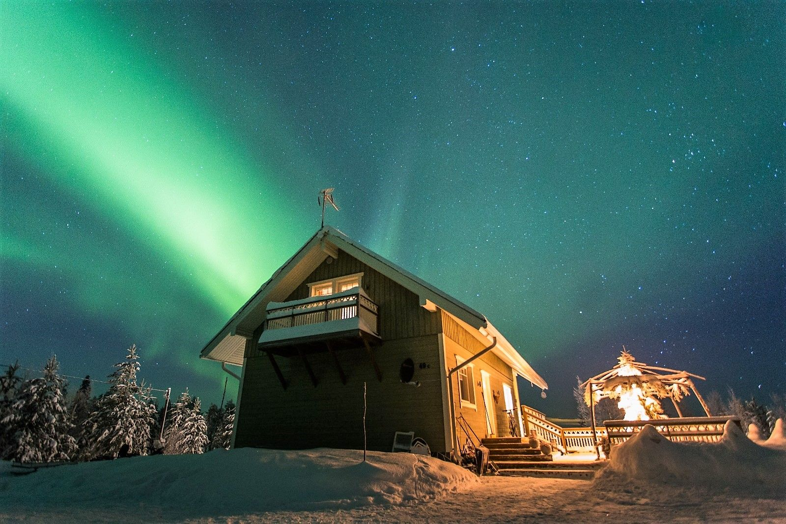 Northern Lights Dancing Above The Cottage Northernlights Winter