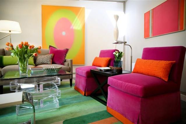 The Violet Chairs Orange Pillows And Green Rug Make This A Triadic Space
