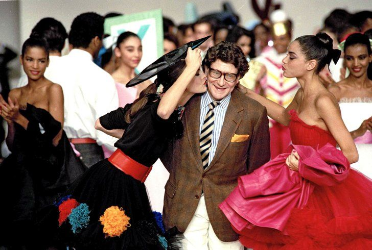 Pin for Later: On His Birthday, a Look Back at the Life of Yves Saint Laurent Yves Saint Laurent Yves Saint Laurent at the end of a fashion show in 1988.