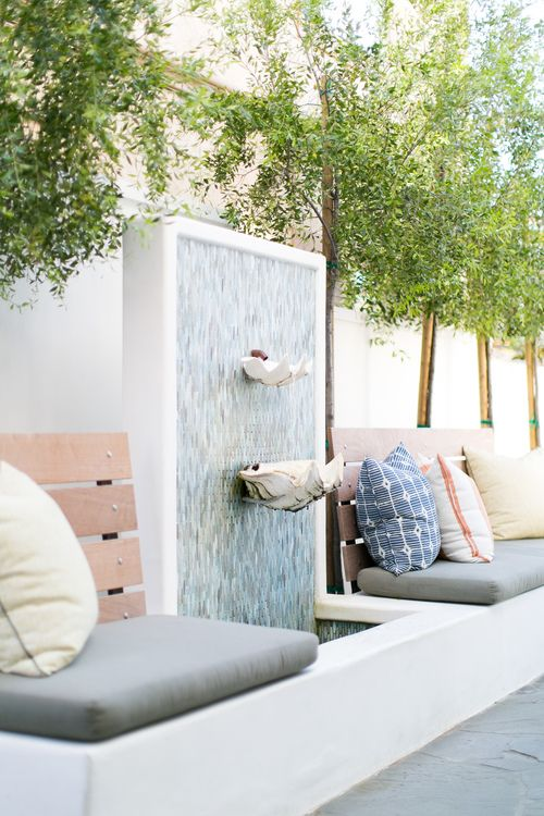 Outdoor Seating with Neutral Pillows + Waterfall Decor | Kelly ...