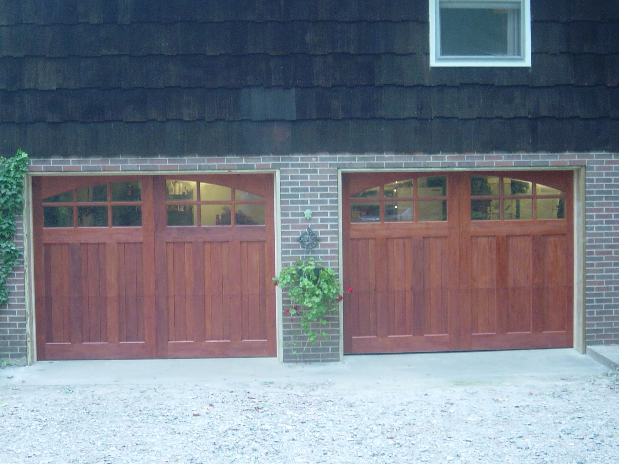 is vs outstanding slide doors ideas carriage door stain exterior overhead new jersey central bridgewater experts reviews loading front grade fire paint what house garage dock the contemporary