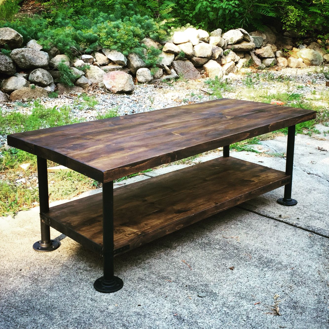 Industrial style wood coffee table with steel pipe legs for Rustic pipe table