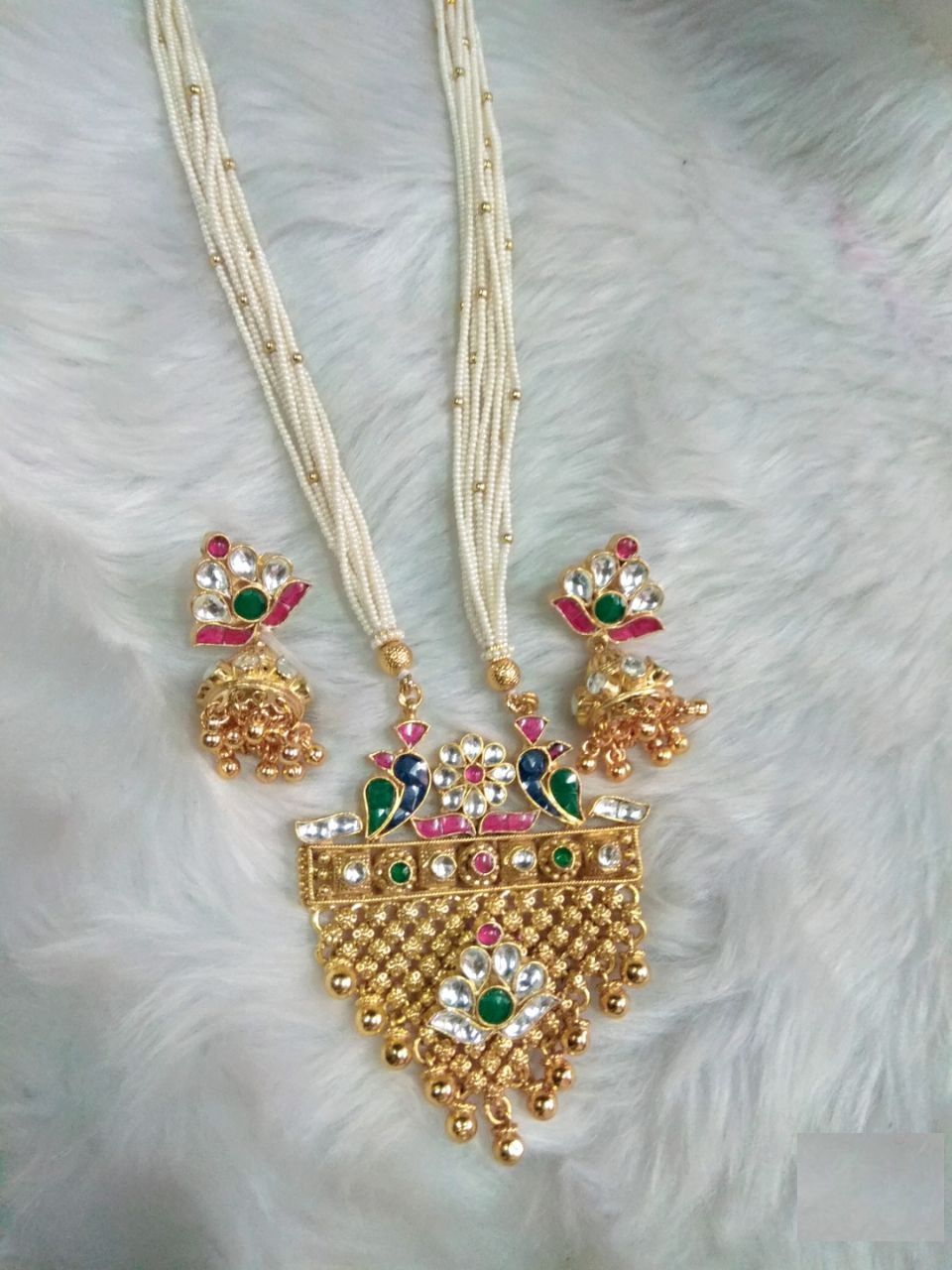 Ethnic milky bonds in twirling flora and fauna motif pendant