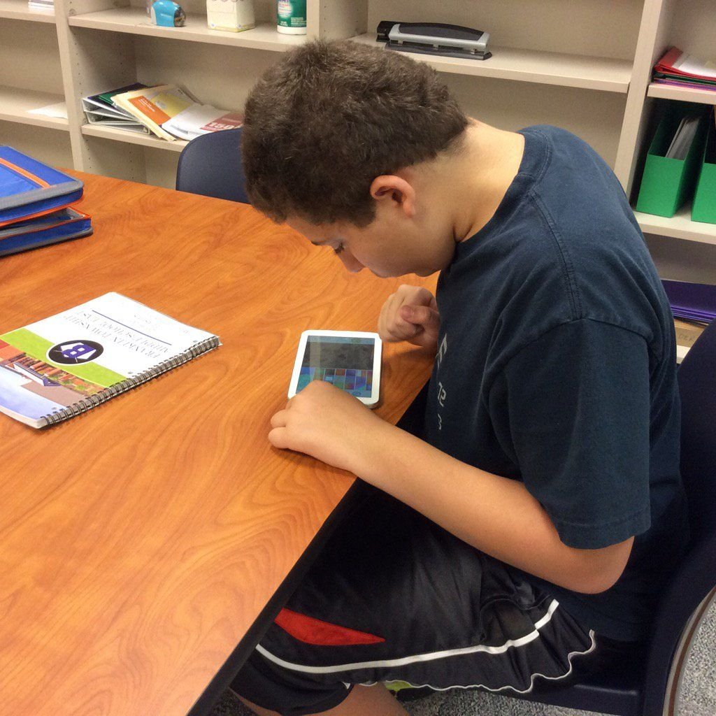 Franklin Township Middle School student making his own TinyTap game