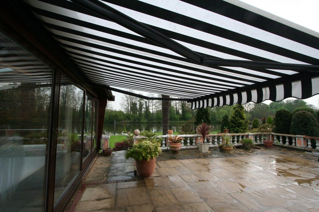 Awning On A Pool Cabin Outdoor Awnings Retractable Awning Patio