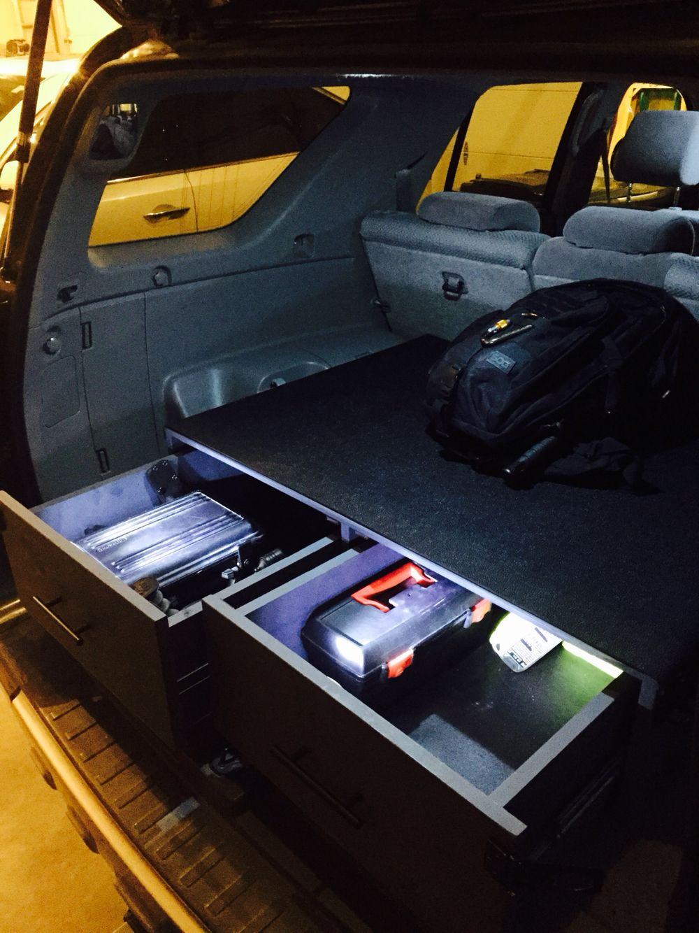 cherokee suv blogs area gun storage load drawers news mobile systems jeep grand drawer