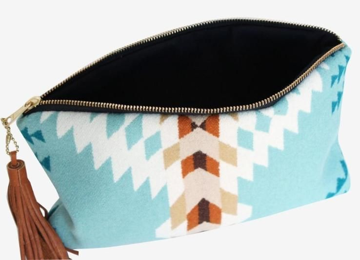 Harlow Clutch with leather tassel detail handmade in Portland, OR.
