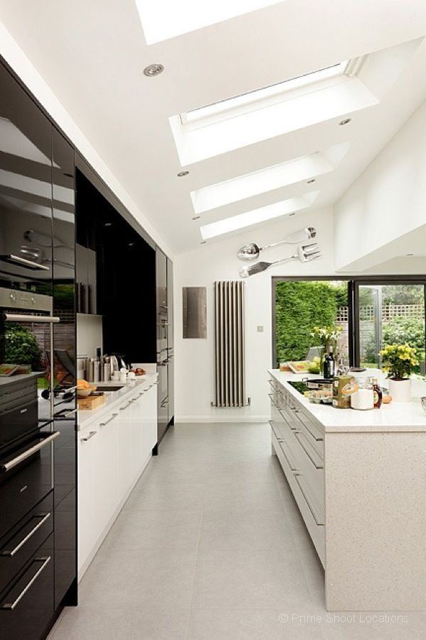 A striking contemporary minimalist kitchen with central for Sleek modern kitchen ideas