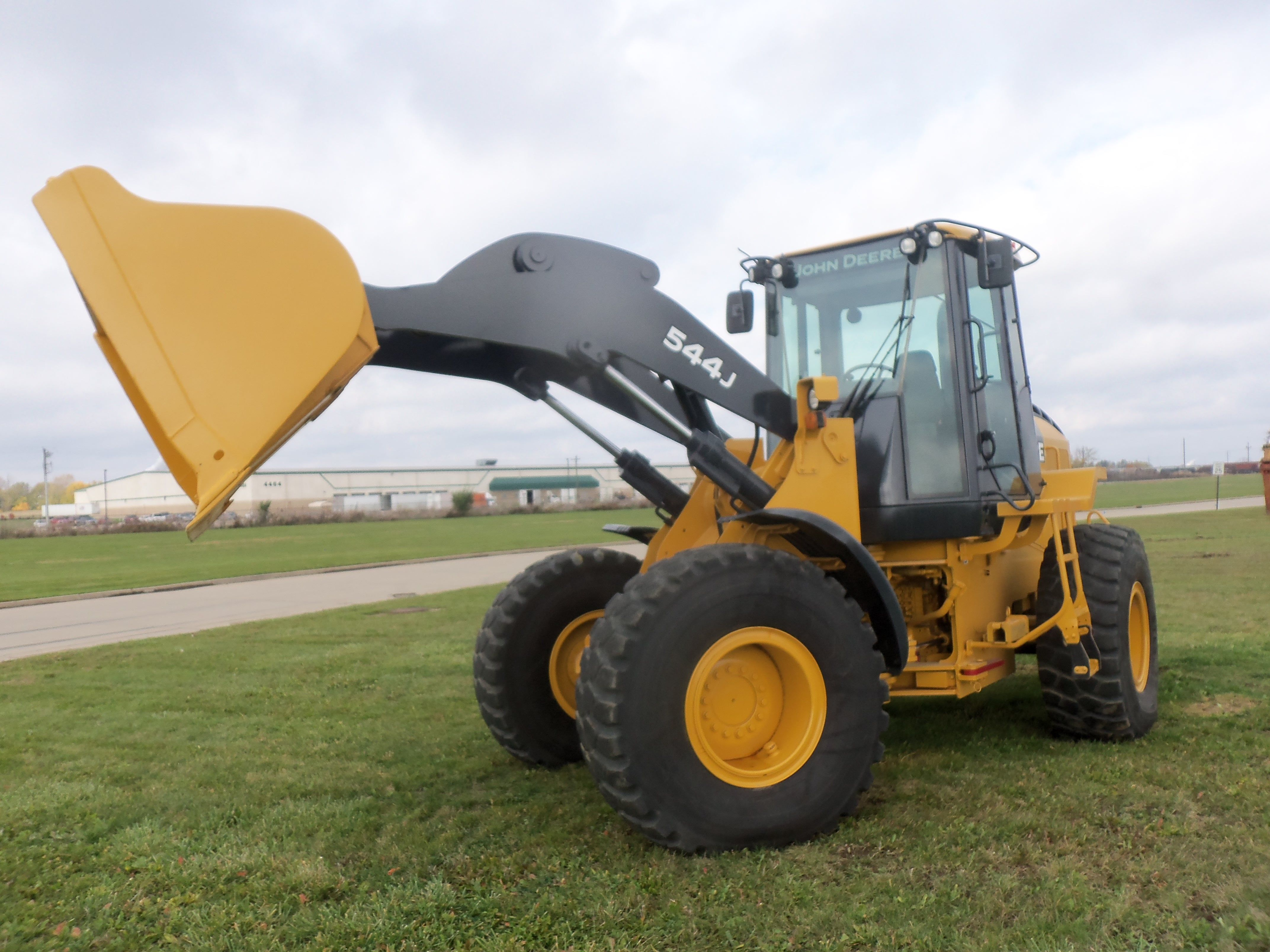 156 gross,134 net hp John Deere 544J with its loader arms up