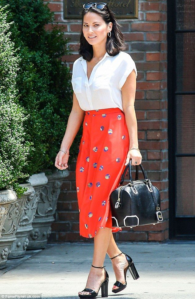 Olivia Munn is prim and proper in a conservative blouse and long skirt