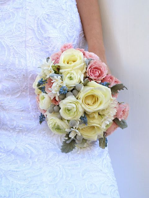 Bridal bouquet with roses, brunia, ranunculus, narcissus, muscari, and dusty miller.  http://colormyworldflowers.blogspot.com