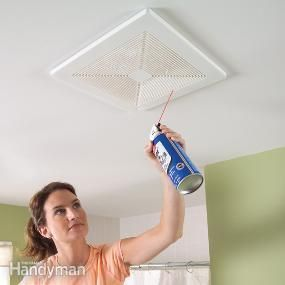 Cleaning bathroom exhaust fan with compressed air while fan is running.