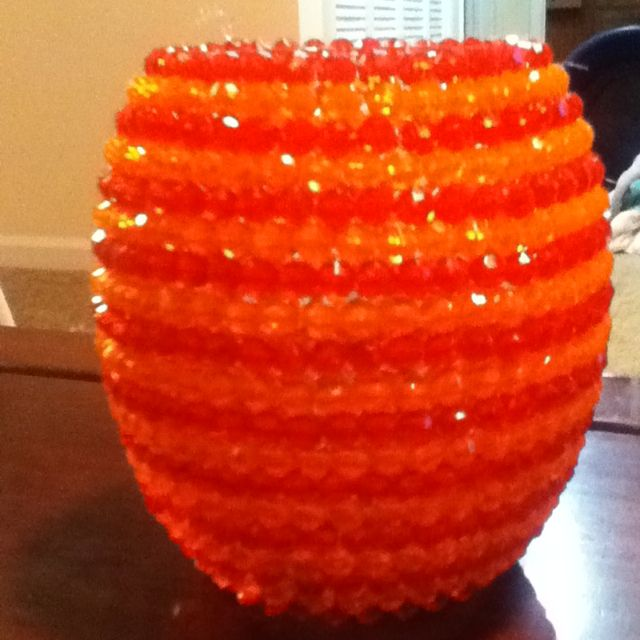 Dollar vases with clear beads, makes a beautiful glowing candle holder. It lights up the whole room. It does take time but it's cool to look at, at night.