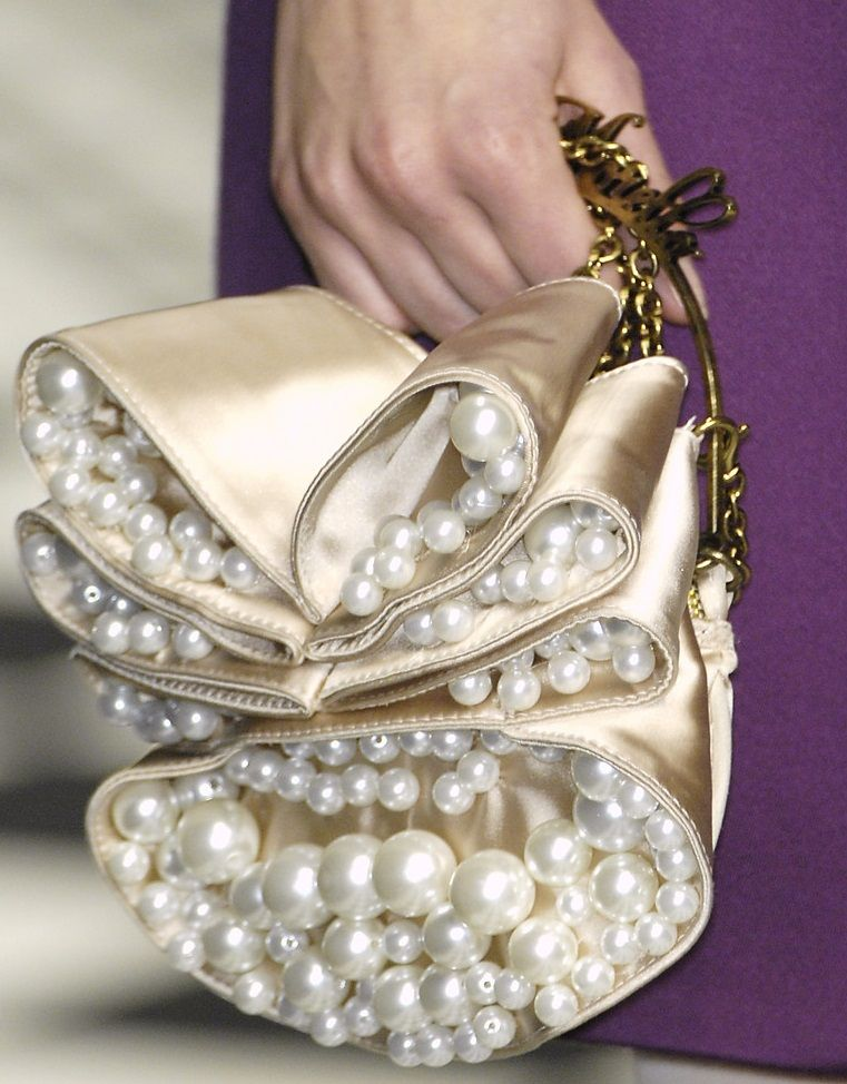 4afe18a78825 Frankie Morello Fall 2009 runway -- beautifully adorned gold clutch with  pearls like champagne bubbles