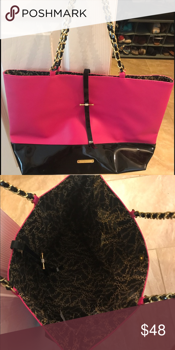 Juicy Couture purse Pink and black Juicy purse. Gold chain straps. Slight break in one of the straps black detail between the gold chains, but will not effect use of the strap. Juicy Couture Bags Totes