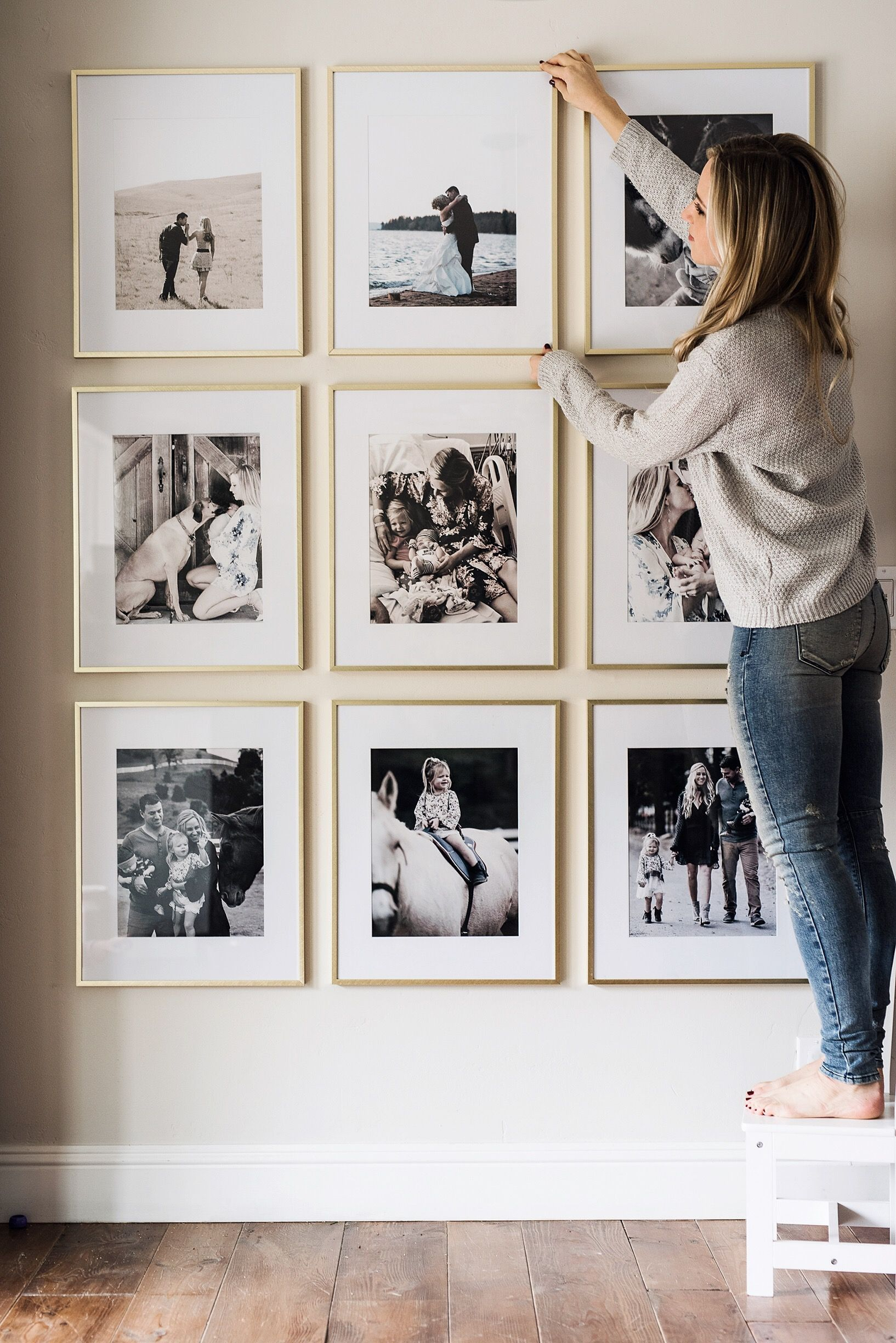 Picture frame wall scheme of black white and gold wall art