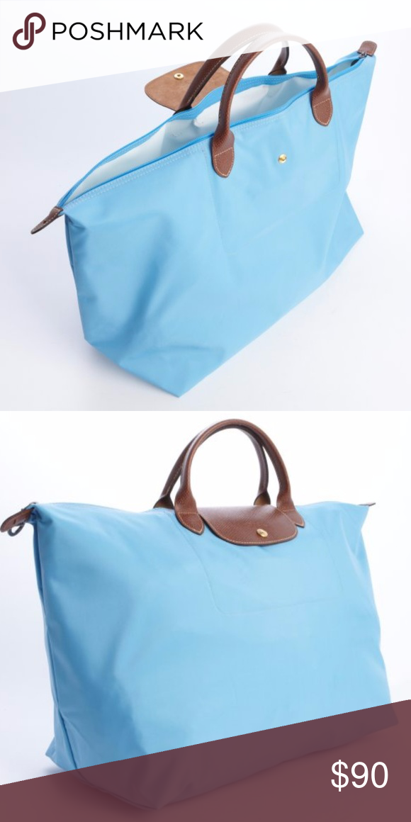 """Longchamp Le Pliage Travel bag XL in light blue This large bag with a  snap-fastening button flap plays with the codes of the Le Pliage bag in a """" travel"""" ... aff52ea61f"""