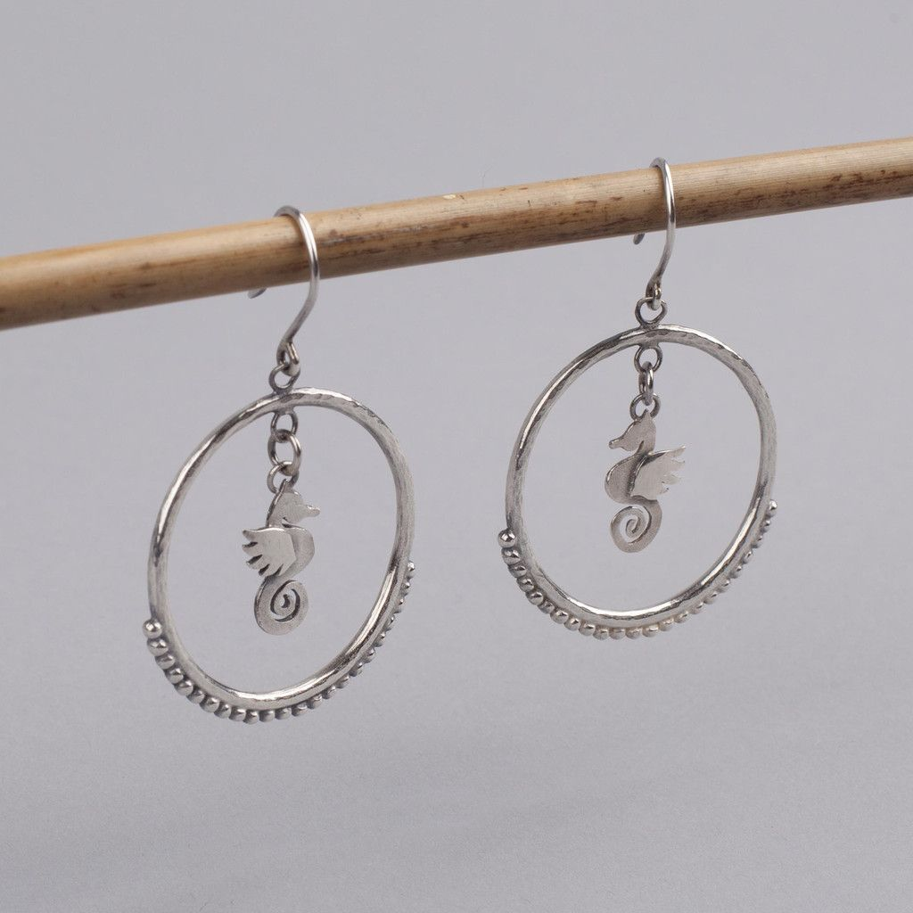 I've admired these earrings for a long time. These are ideal for those who want to remind themselves of the summer and the seaside during the colder months. Seahorse Earrings - Sophie Harley Roo's Beach £218