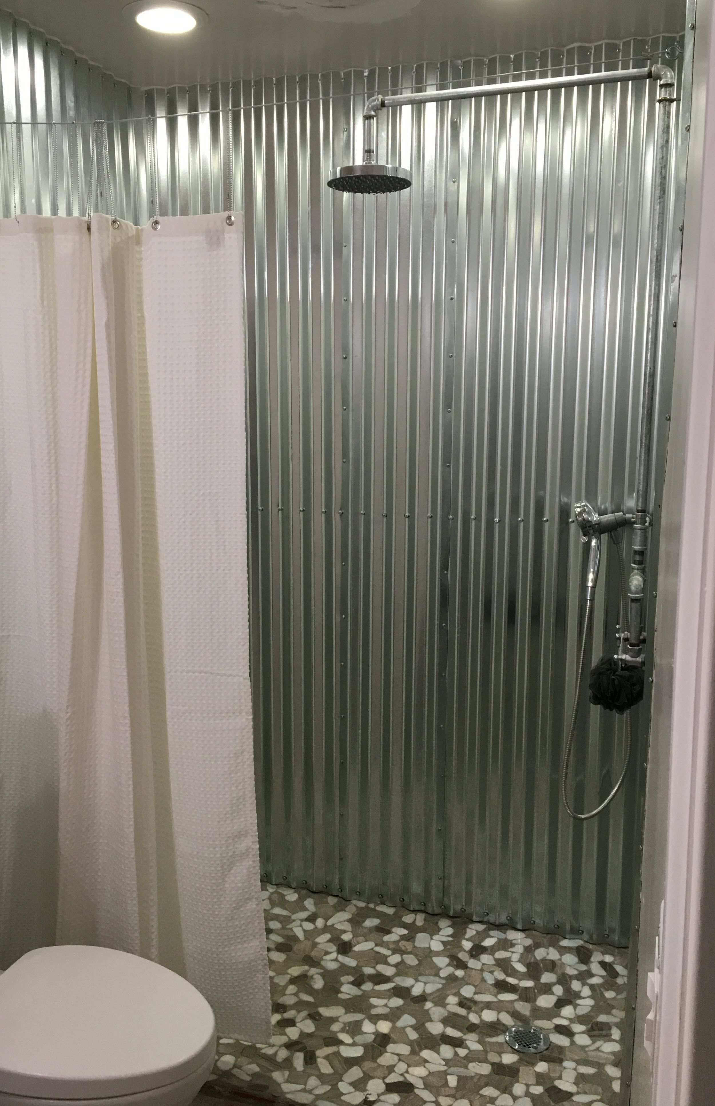 Modern Country Industrial Shower Built With Corrugated Metal Walls. Exposed