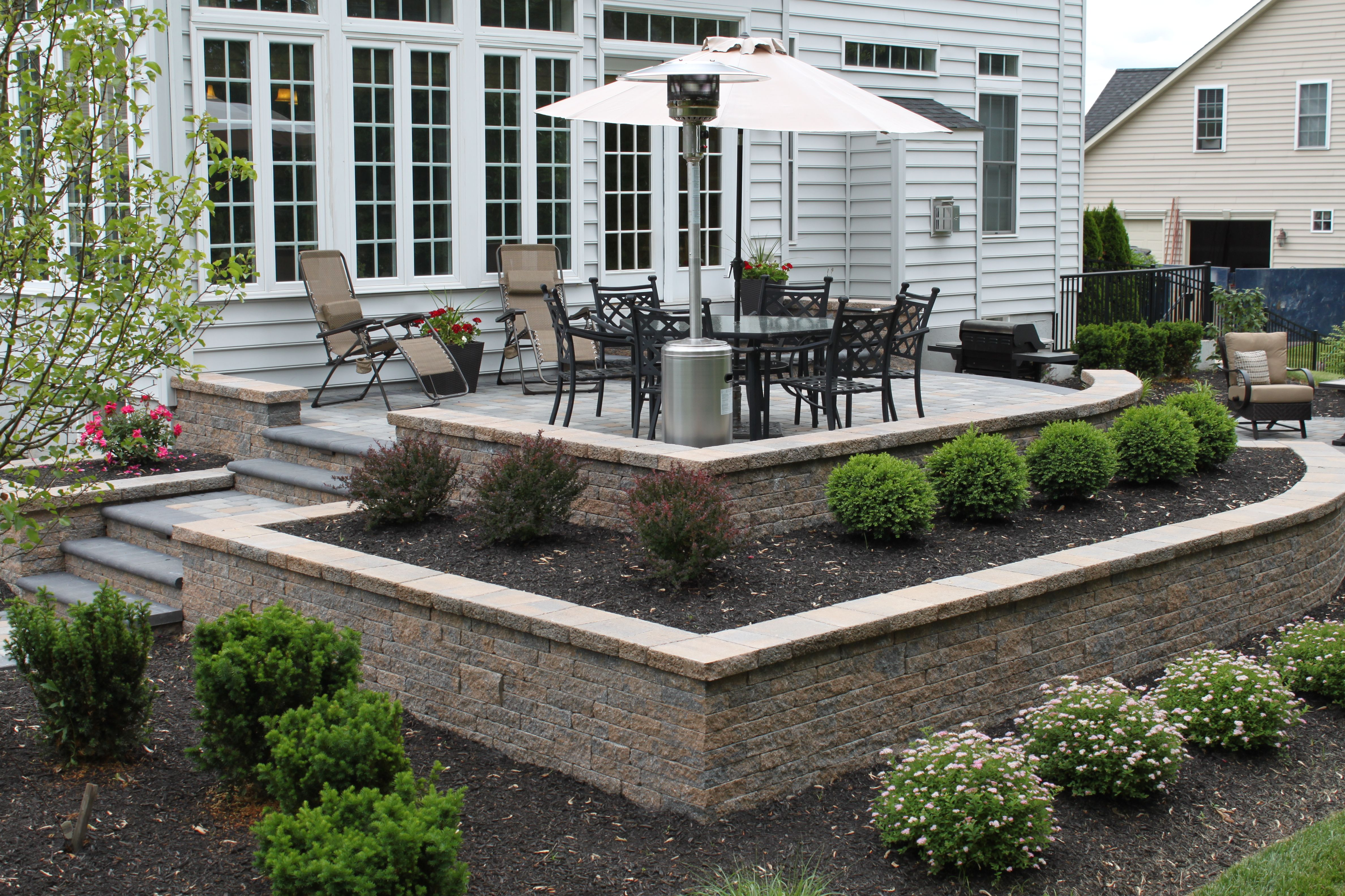 Raised patio using planter boxes and retaining wall, by R ... on Back Wall Garden Ideas id=67764