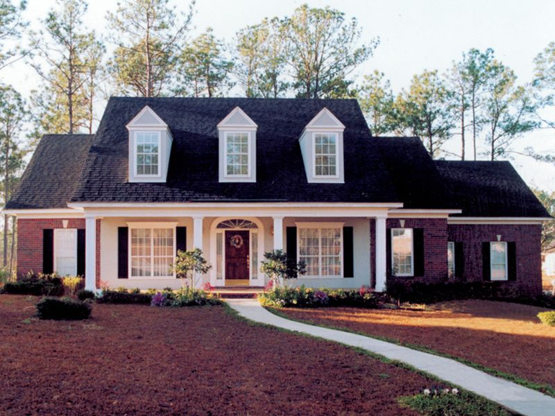 1950 cape cod brick front brick home with sweeping front covered porch and triple dormers - House plans dormers ...