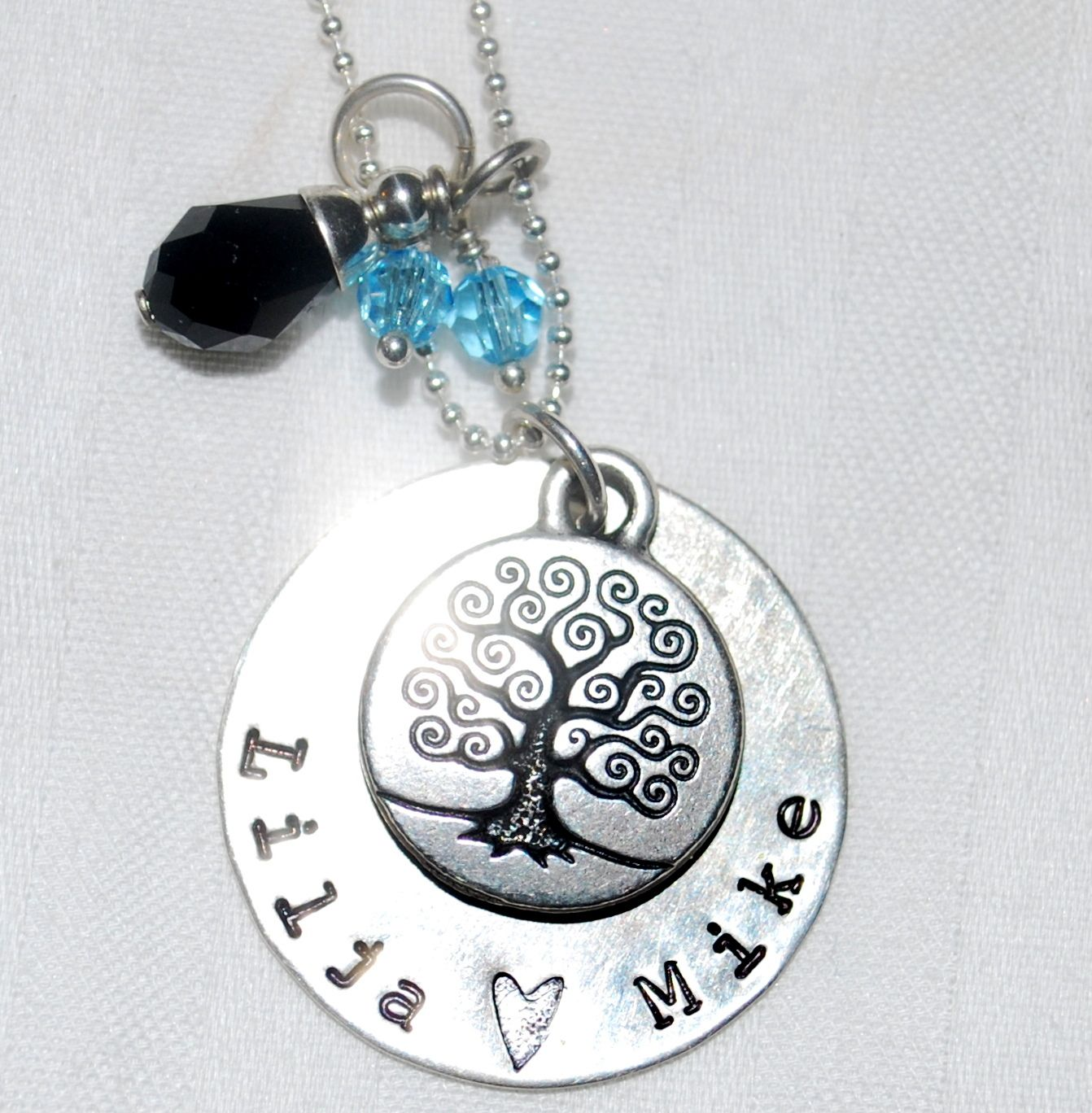 www.etsy.com/shop/patricia8anderson  Under the tree of life is our anniversary date. We were married in March so I did two aquamarine stones and the black stone is for being married on Friday the 13th.   LOVE THIS!!!