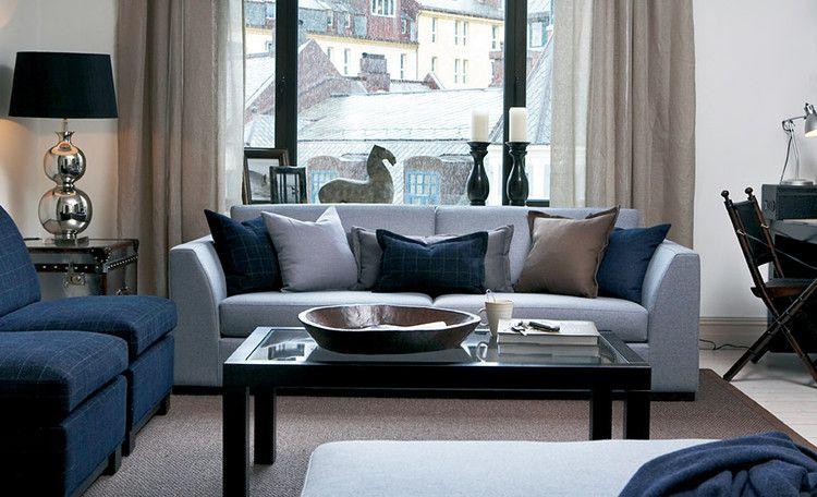 Mørk grå sofa interiør