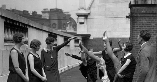 Chorus girls work on their high kicks on the roof of the Gaiety Theatre in London, ca. 1920s