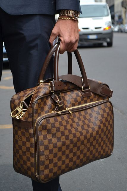 Louis Vuitton man bag or brief case. i do believe i ve become a bit bag-obsessed  lately. can you blame me  7b915e6d51656