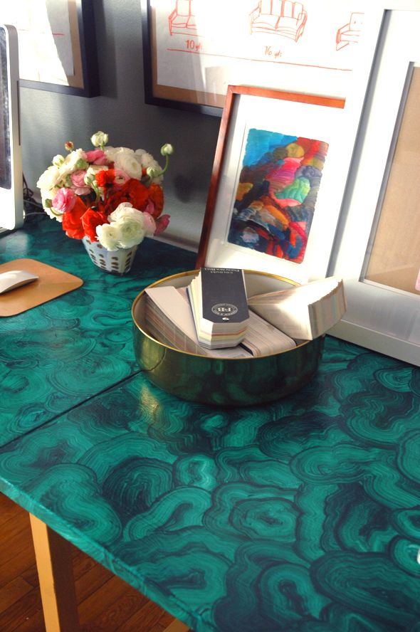 So impressed, she painted a faux stone table top...the whole office ...