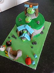 Angry Birds has been the most downloaded game for i-phone for a long time now (I am completely addicted to it), so when I was able to create my own angry birds level cake I was thrilled. My favourite piggy is the one with the moustache!