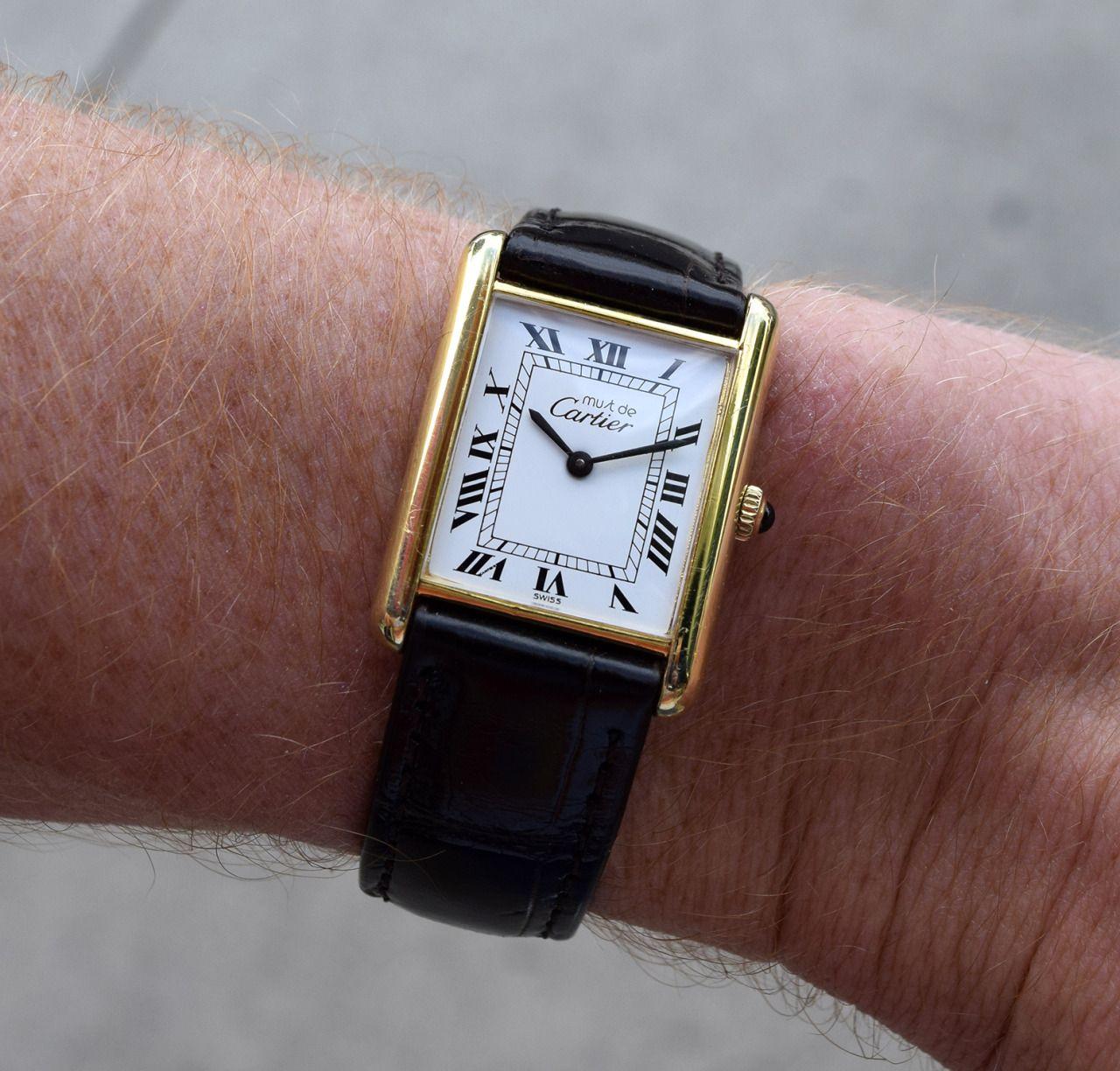94a9787403a2 A 1990 s Cartier Must de Tank Standard Men s Size timepiece. This watch  features an 18K
