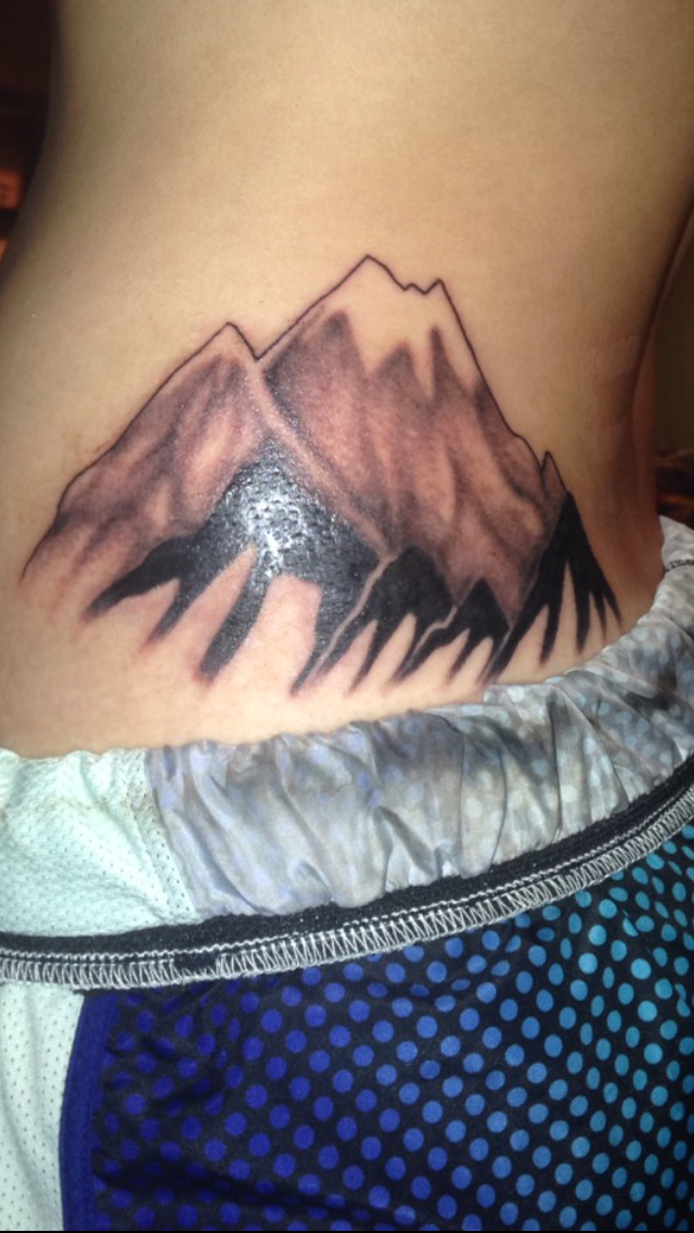Mountain tattoo. This is a tattoo of Longs Peak in Colorado