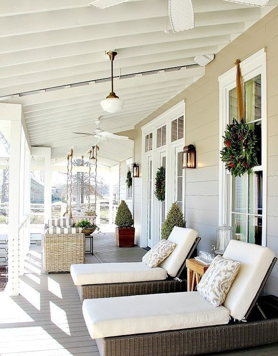 back porch with loungers and a swining sofa to sunbathe Outdoors